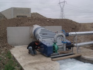 Irrigation pumping water turbine in operation.